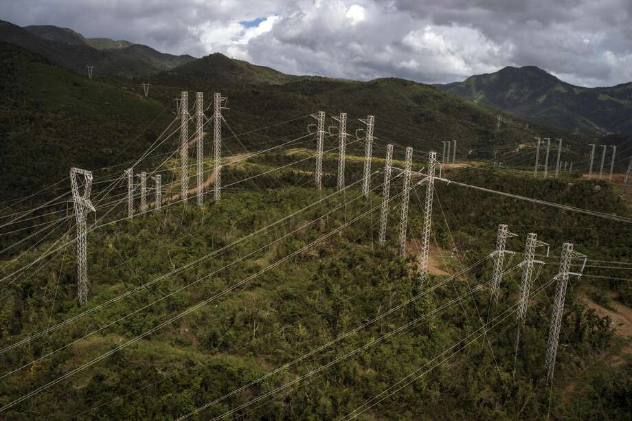 Transmission towers carry power lines through the mountains in eastern Puerto Rico on Feb. 4, 2018. It took months to restore electricity in Puerto Rico after hurricanes dealt a one-two punch, and the system's future is far from certain. (Todd Heisler/The New York Times) Photo: TODD HEISLER/NYT