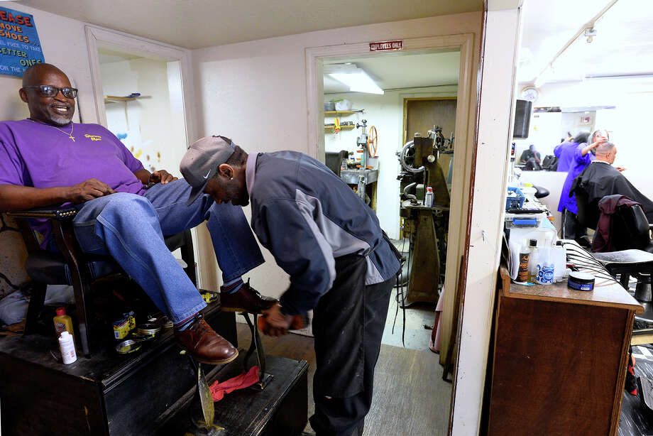 Jerald Glasper gets his shoes shined by cobbler Mike Johnson at Longwear Shoe Repair and Barber Shop. Johnson has been doing shoe repair since 1992 after learning the trade from Harold Standberry, the shop's founder.  Photo taken Thursday 3/29/18 Ryan Pelham/The Enterprise Photo: Ryan Pelham / ©2017 The Beaumont Enterprise/Ryan Pelham