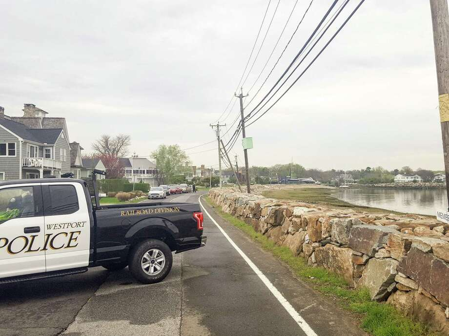 Harbor Road was closed in Westport, Conn. after a man's body was found on the waterline of the Saugatuck Shores beach area on Friday, May 4, 2018. According to Lt. Jillian Cabana foul play is not suspected. Photo: Thane Grauel / Hearst Connecticut Media / Norwalk Hour