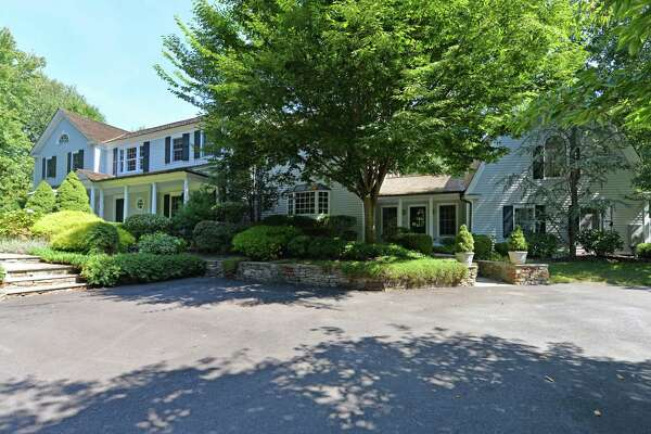The custom colonial house at 1800 Hillside Road is called Serenity Hill by its owners because of its private setting and high elevation.