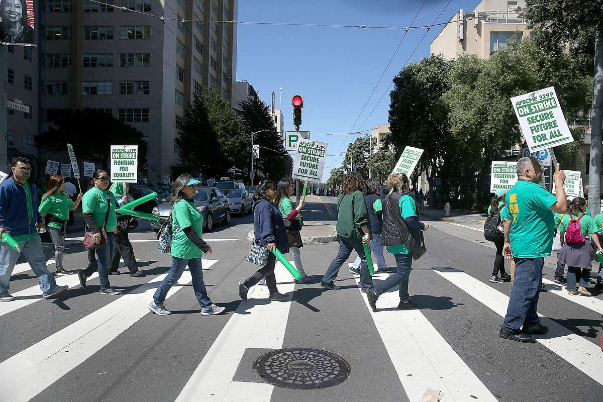 Health care workers at UCSF Medical Center on Parnassus Ave. protest to increase salaries and address racial and gender pay inequalities Monday, May 7, 2018 in San Francisco.