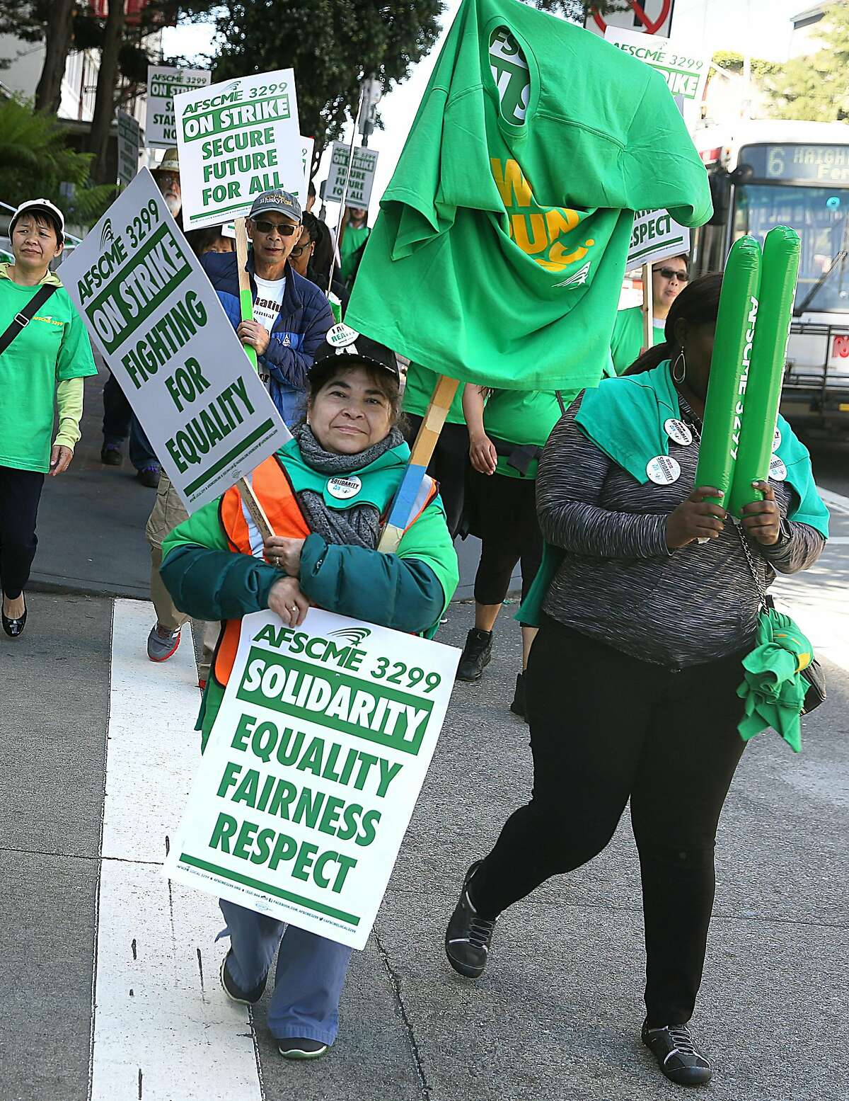 Patient care health care worker Maria Luna protests at UCSF Medical Center on Parnassus Ave. to increase salaries and address racial and gender pay inequalities Monday, May 7, 2018 in San Francisco.