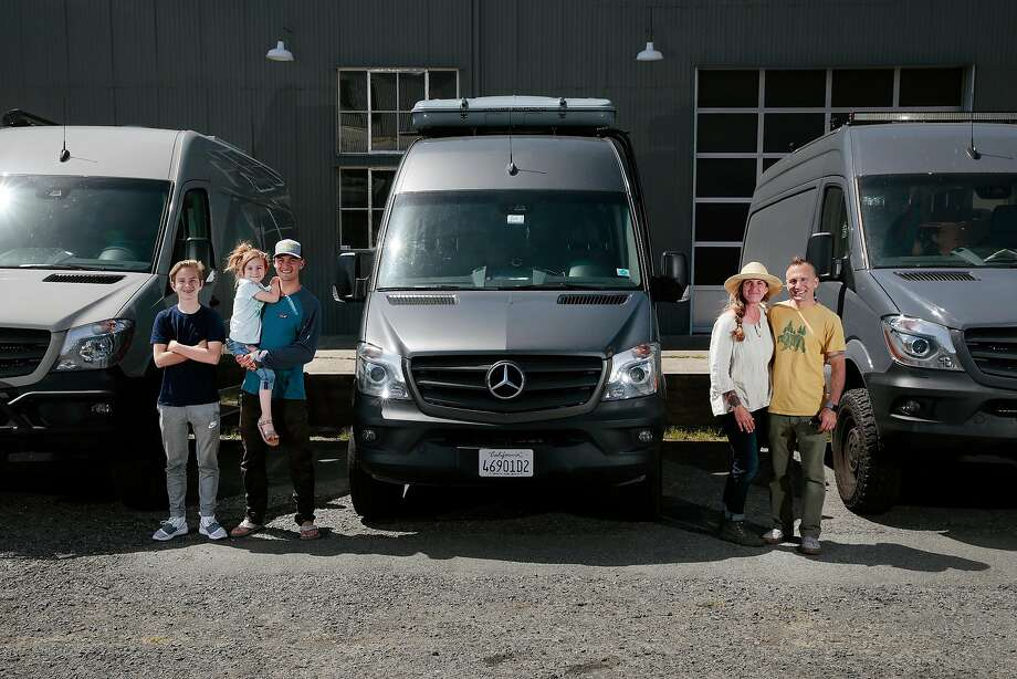 Jen and Cemil Hope, with three of their four children, Christopher, 12, Amelie, 5, and Bodhi, 19, pose for a portrait with three Mercedes-Benz Sprinter cargo vans in Petaluma. Photo: Ramin Rahimian / Special To The Chronicle