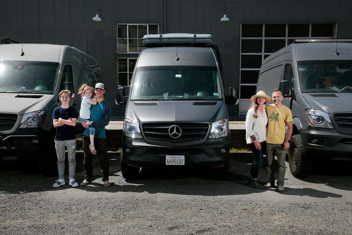 Jen and Cemil Hope, along with three of their four children, Christopher, 12, Amelie, 5, and Bodhi, 19, pose for a portrait with three (two of which are theirs) Mercedes-Benz Sprinter cargo vans in Petaluma, California, Wednesday, May 2, 2018. Ramin Rahimian/Special to The Chronicle