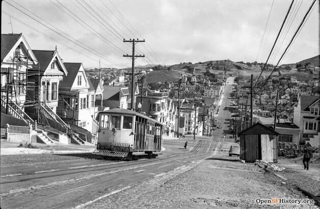 A pretty shot of the Castro cable car heading up Castro St., near Alvarado in 1938.  Photo courtesy ofOpenSFHistory. Photo: OpenSFHistory/Courtesy