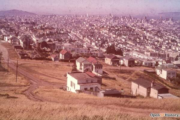 The view toward Noe Valley in San Francisco, circa 1955. The unpaved intersection is Douglass and Valley streets.