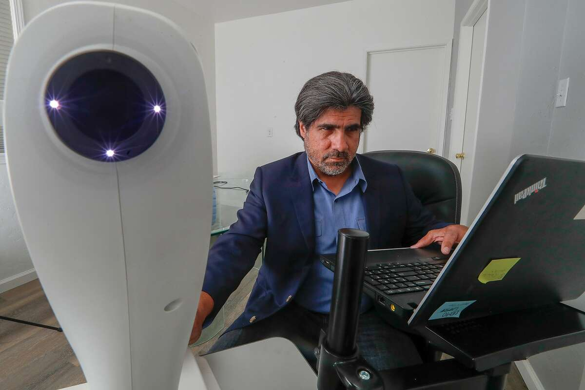 Jorge Cuadros, OD, PhD demonstrates the use of the Optovue iCam a retinal camera at his office in San Jose, California. Monday, May 7, 2018. Cuadros is using Google's AI technology to help determine if patients have diabetic retinopathy, a disease that can cause blindness.