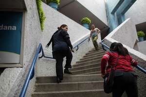 (Left to right) Marcela Valdez and Martha Olmedo climb the stairs to Miguel Alem‡n's City Hall in Tamaulipas, Mexico on May 2, 2018. Valdez's son disappeared while Olmedo lost five children and two grandchildren. (Tamir Kalifa for The San Antonio Express-News)
