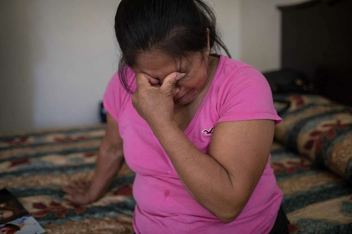 Martha Olmedo, who lost five children and two grandchildren during the drug war, is overcome with emotion while looking at images of her family at her hotel in Miguel Alem‡n in Tamaulipas, Mexico on May 2, 2018. (Tamir Kalifa for The San Antonio Express-News)