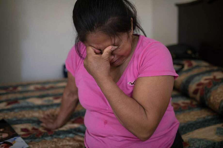Martha Olmedo, who lost five children and two grandchildren during the drug war, is overcome with emotion while looking at images of her family at her hotel in Miguel Alem‡n in Tamaulipas, Mexico on May 2, 2018. (Tamir Kalifa for The San Antonio Express-News) Photo: Tamir Kalifa, FRE / Tamir Kalifa For The San Antonio Express-News / Tamir Kalifa