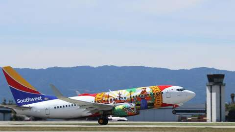 """<p>Southwest's specially painted """"Florida One"""" at SJC for the inaugural Orlando"""