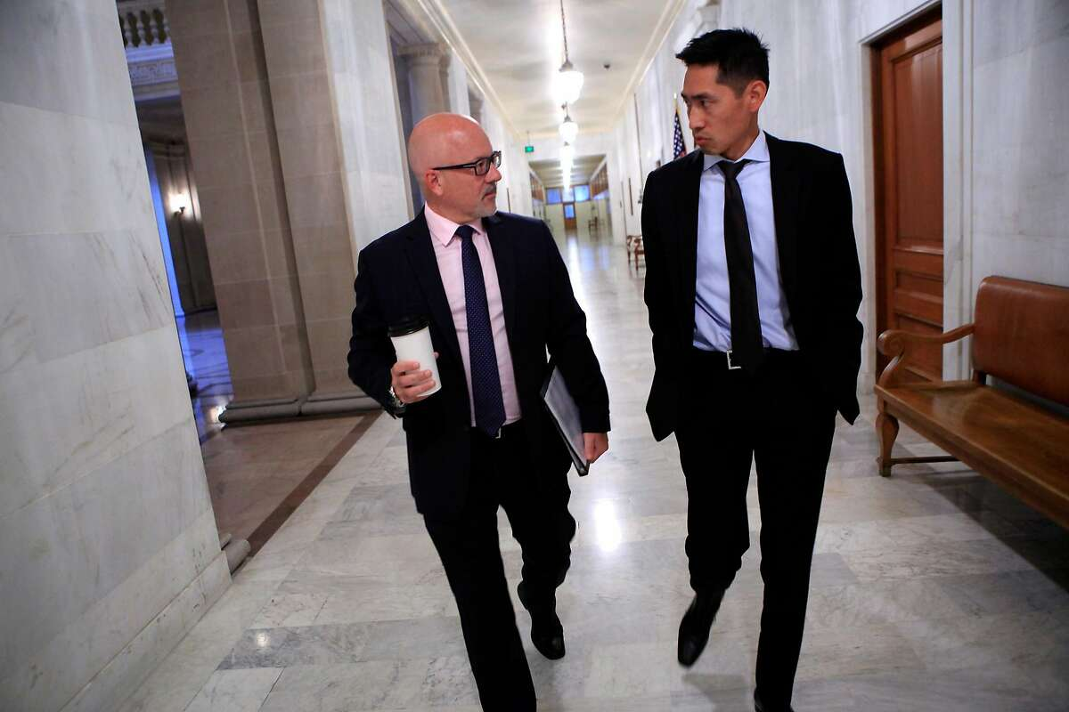 Steve Kawa, Chief of Staff to Mayor Ed Lee, left, talks with Economic Development Director Todd Rufo as they head to a Mayor's staff meeting at City Hall in San Francisco, CA, Thursday, August 21, 2014.