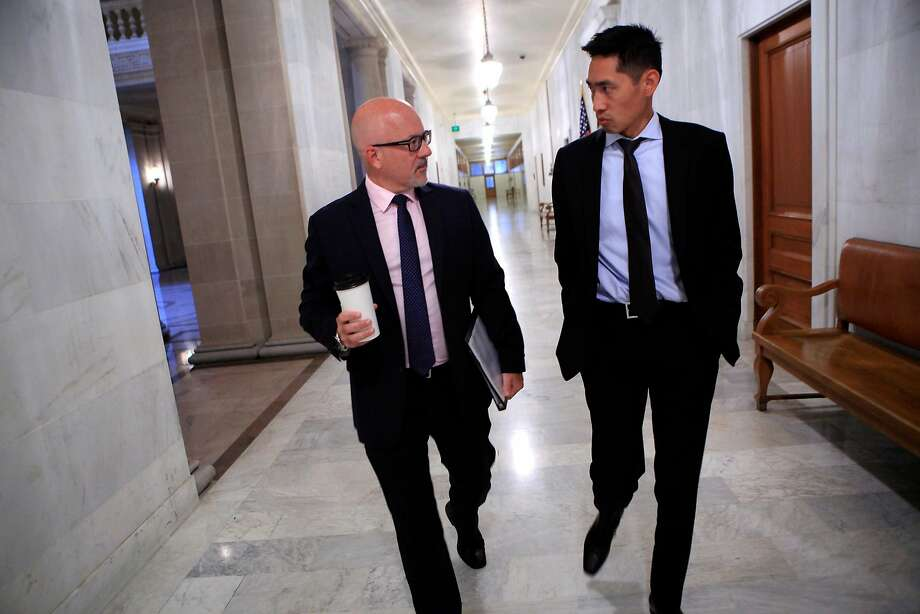 Steve Kawa, Chief of Staff to Mayor Ed Lee, left, talks with Economic Development Director Todd Rufo as they head to a Mayor's staff meeting at City Hall in San Francisco, CA, Thursday, August 21, 2014. Photo: Michael Short / The Chronicle 2014