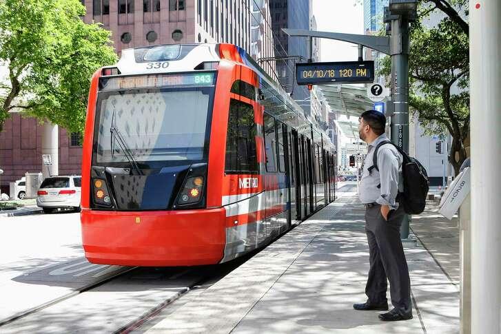 A Metropolitan Transit Authority light rail train pulls into the Theater District platform on April 10.