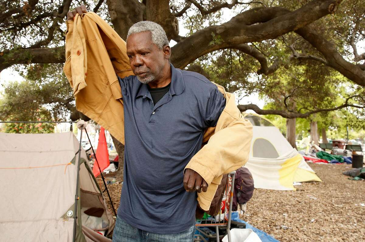 Quincy Collins grabbed a coat from his tent in Lafayette Park, after he talked about the NBA Golden State Warrior who have their practice facility a little over a block away from their homeless encampment in Oakland, Ca. on Thurs. May 3, 2018.