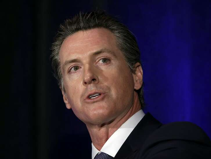 FILE - In this March 8, 2018 file photo California gubernatorial candidate Lt. Gov. Gavin Newsom discusses the state's housing problems at a conference in Sacramento, Calif. Newsom, a Democrat, is one of six candidates running to replace Gov. Jerry Brown. (AP Photo/Rich Pedroncelli, File)