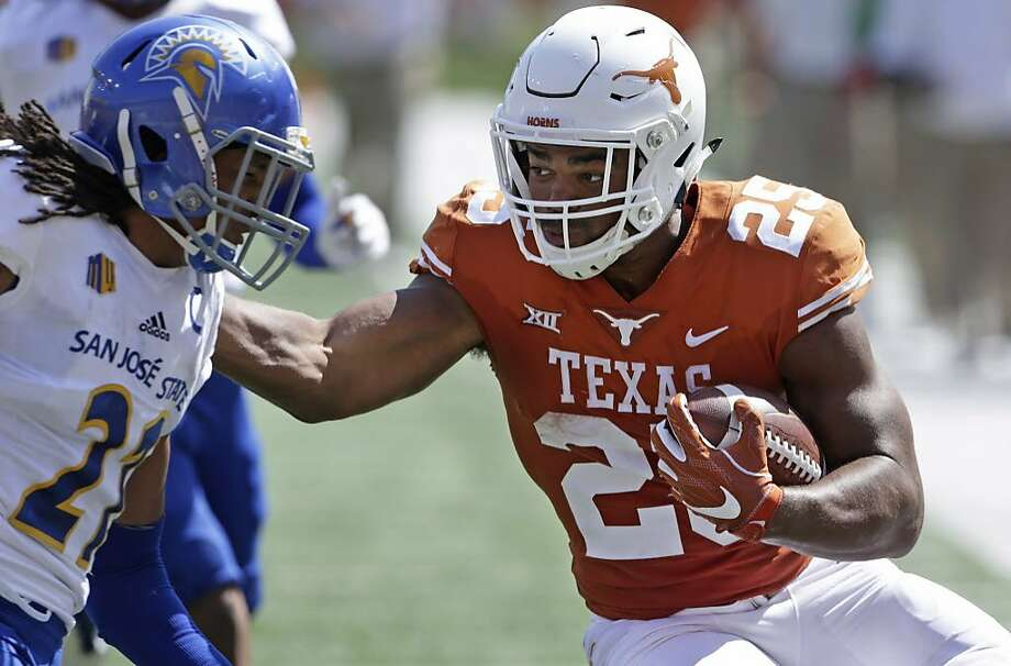 Running back Chris Warren declared for the NFL after three seasons at Texas, where he totaled 204 carries for 1,150 yards and 13 touchdowns. Photo: Tom Reel, San Antonio Express-News