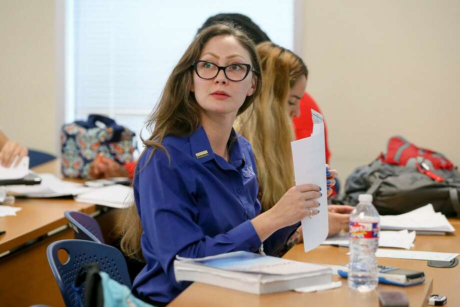 Katrina King prepares for her physics class at St. Philip's College on Wednesday, May 2, 2018.  MARVIN PFEIFFER/mpfeiffer@express-news.net Photo: Marvin Pfeiffer, Staff / San Antonio Express-News / Express-News 2018