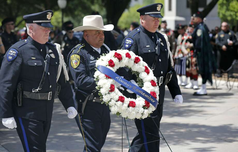 Bexar County Sheriff's Office Honor Guard Deputy Raul Medellin (center) carries a memorial wreath during the Texas Peace Officers' Memorial Service held Monday at the Texas State Capitol in Austin. Photo: Edward A. Ornelas /San Antonio Express-News / © 2018 San Antonio Express-News