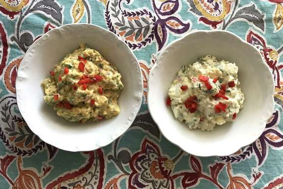Adding a few herbs and condiments can totally dress up store-bough potato salad — to the point people will think it's homemade. Dressed-up Hill Country Fare Mustard Potato Salad (left) and mayo-based Homestyle Potato Salad.