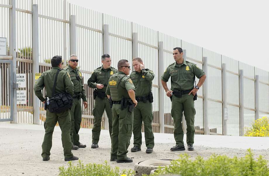 Border Patrol agents patrol the area near where Attorney General Jeff Sessions addresses the media during a press conference at Border Field State Park  on May 7, 2018 in San Ysidro, CA.  Sessions was on a visit to the border along with ICE Deputy Director Thomas D. Homan to discuss the immigration enforcement actions of the Trump Administration. Photo: Sandy Huffaker, Getty Images