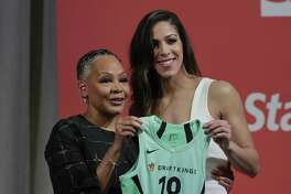 Former UConn standout Kia Nurse, right, made her pro debut on Monday night in an exhibition game at Mohegan Sun Arena.