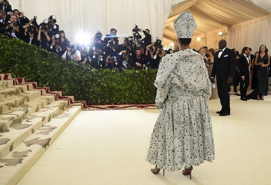 "Rihanna at the Metropolitan Museum of Art's Costume Institute benefit gala celebrating the opening of the ""Heavenly Bodies: Fashion and the Catholic Imagination."" Photo: Evan Agostini / Associated Press"
