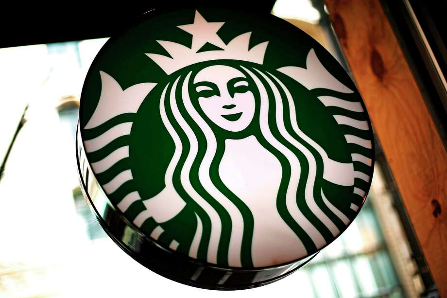 FILE- This March 24, 2018, file photo shows a sign in a Starbucks located in downtown Pittsburgh. Nestle has entered an agreement to bring Starbucks products to millions of homes worldwide, announced Monday, May 7, 2018. (AP Photo/Gene J. Puskar, File) Photo: Gene J. Puskar / Copyright 2018 The Associated Press. All rights reserved.