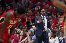 New Orleans Pelicans head coach Alvin Gentry calls from the bench in the second half of Game 4 of a second-round NBA basketball playoff series against the Golden State Warriors in New Orleans, Sunday, May 6, 2018. (AP Photo/Gerald Herbert)