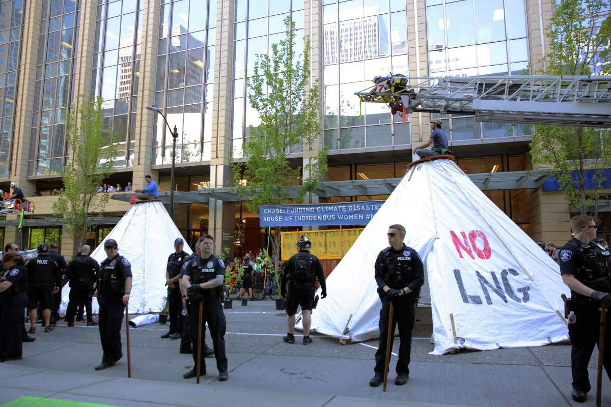 """Environmental activists, including those from the group """"Protect Our Salish Sea,"""" erected four large """"tarpees"""" in the middle of 2nd Avenue between Union and University Streets, blocking traffic for several hours, Monday, May 7, 2019. Demonstrators protested the Trans-Mountain Pipeline expansion in Canada, to 890,000 barrels of oil a day. The oil would be exported from an oilport near Vancouver through waters shared by the U.S. and Canada."""