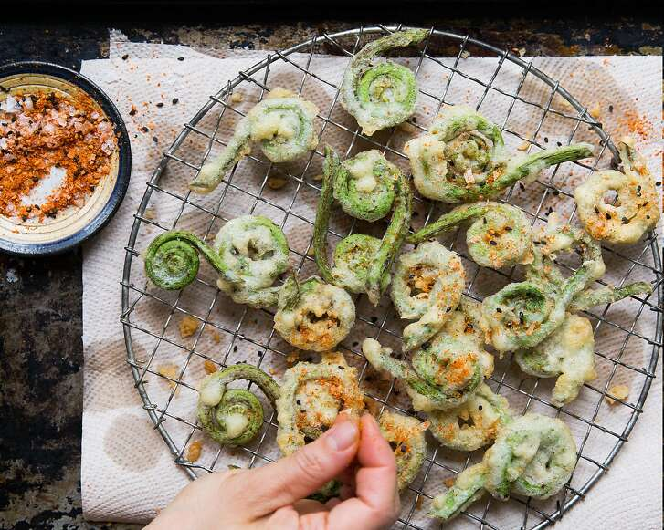 "Fiddlehead tempura with Sriracha creme fraiche, one of the recipes featured in ""The Berkeley Bowl Cookbook,"" by Laura McLively (Parallax Press; $34.95)."