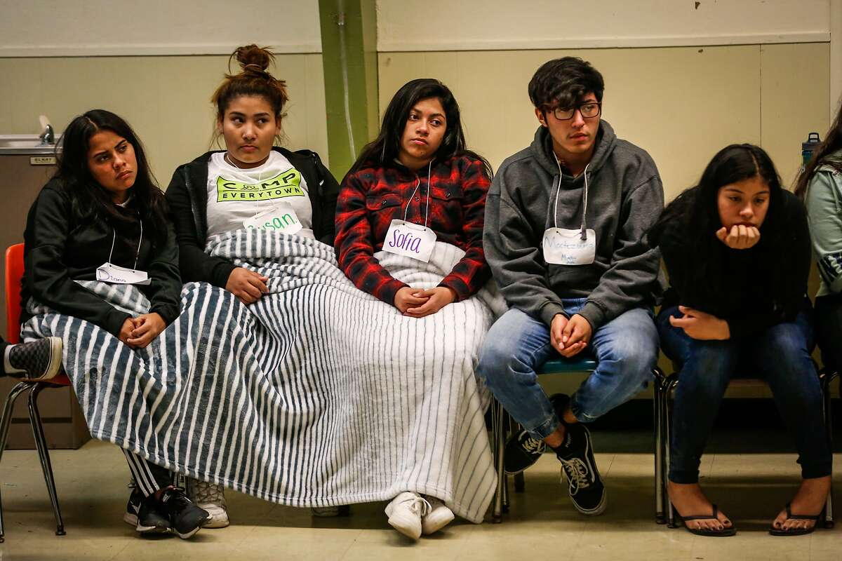 Students listen during an exercise at Camp Everytown in Boulder Creek, California, on Thursday, Oct. 12, 2017.