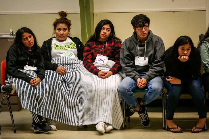 Students listen during an exercise at Camp Everytown in Santa Cruz, California, on Thursday, Oct. 12, 2017.