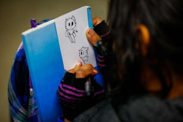 Jessica Vasquez Aguilar, 14, doodles on a piece of paper during an exercise at Camp Everytown.