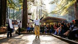 Facilitator Kenneth Naranja emphatically lifts his arms while telling a story to high schoolers at Camp Everytown in Santa Cruz, California, on Thursday, Oct. 12, 2017.