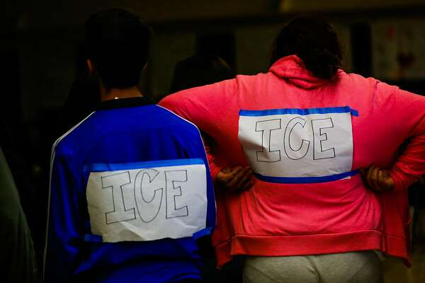 (l-r) Cesar Becerra, 17 and Wendy Aguirre, 15, dress up as ICE agents during a skit in which they were to reflect aspects of their culture for other students at Camp Everytown in Boulder Creek, California, on Friday, Oct. 13, 2017.