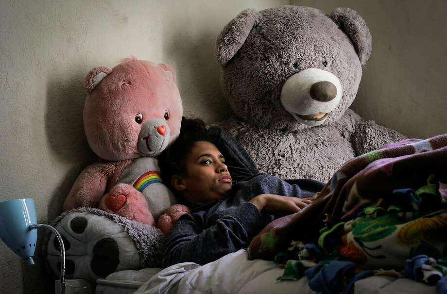 Carmel Evans, 18, who attended the Camp Everytown fall retreat for South Bay high school students, watches television in her room back home in San Jose. Carmel found the intense camp experiences both uplifting and triggering. Photo: Gabrielle Lurie / The Chronicle