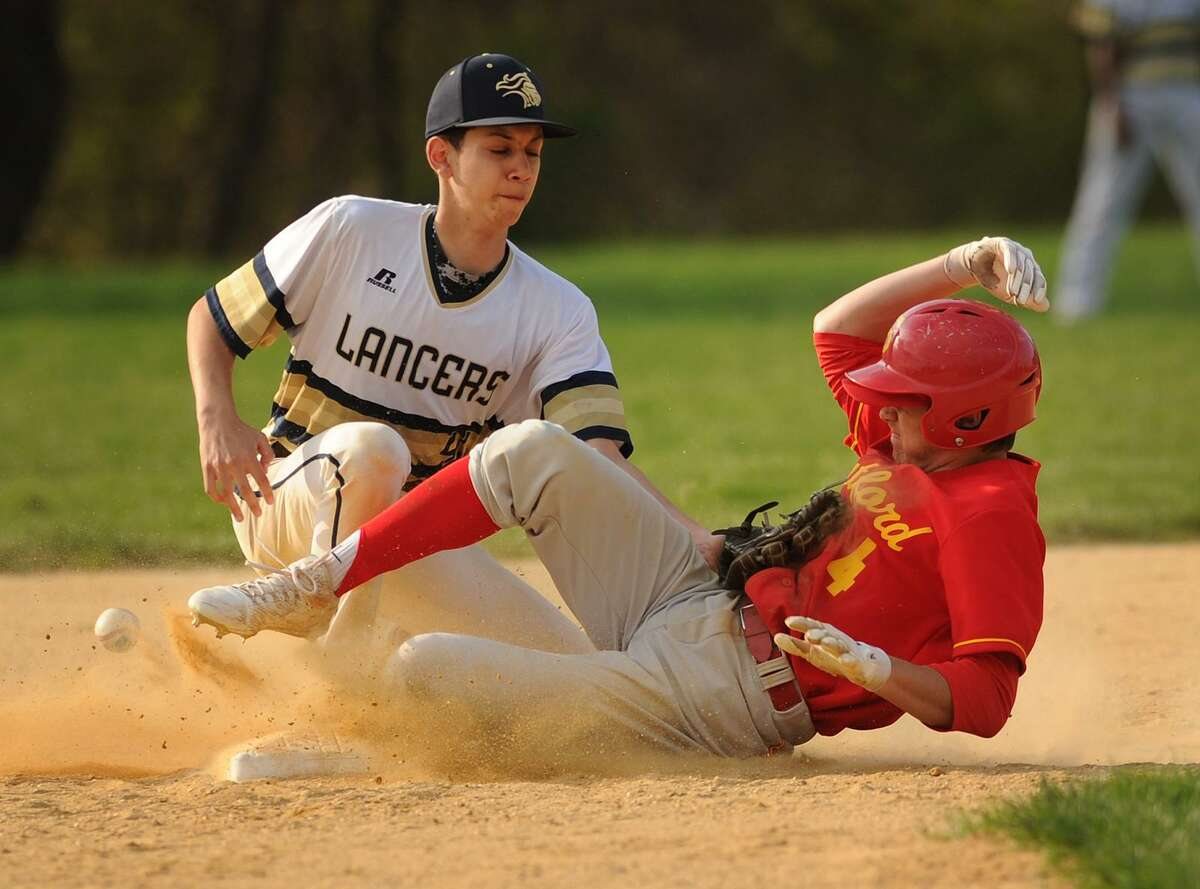 Stratford's Brayden Seaburg steals second as the ball gets away from Notre Dame second baseman Dave Marquez in the 4th inning of their baseball game at Notre Dame High School in Fairfield, Conn. on Monday, May 7, 2018.