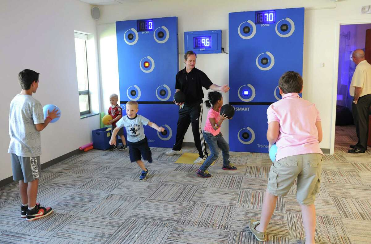 Children play games in the playroom at the newly opened Spotted Zebra Learning Center during a ribbon cutting ceremony Thursday, June 19, 2014, in Colonie, N.Y. (Lori Van Buren / Times Union archive)