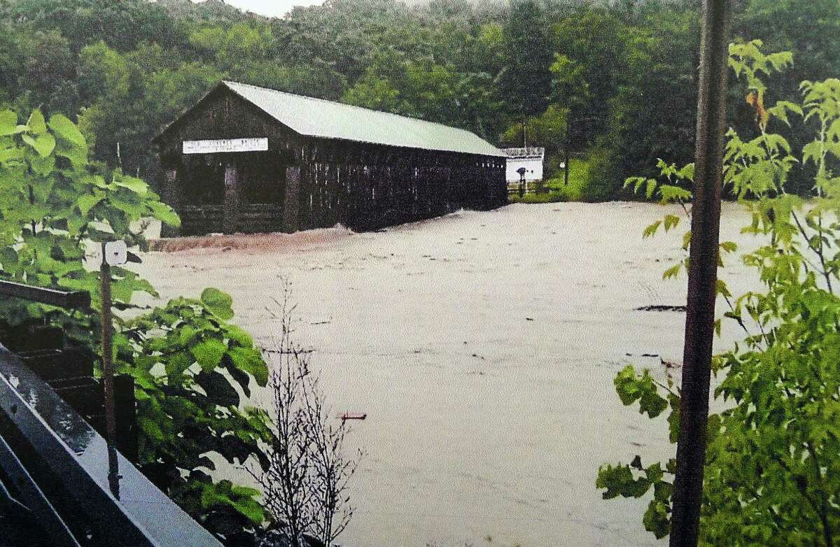 The historic Blenheim covered bridge during flooding of the Schoharie Creek in Blenheim, N.Y. ( photo courtesy of Gerald Felter )
