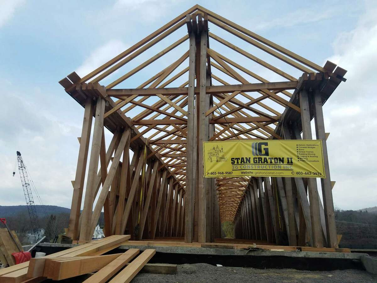 Workers are nearing the finish line for the reconstruction of an historic covered bridge in Blenheim, Schoharie County, that was washed away during flooding from Tropical Storm Irene. (Chris Churchill / Times Union)
