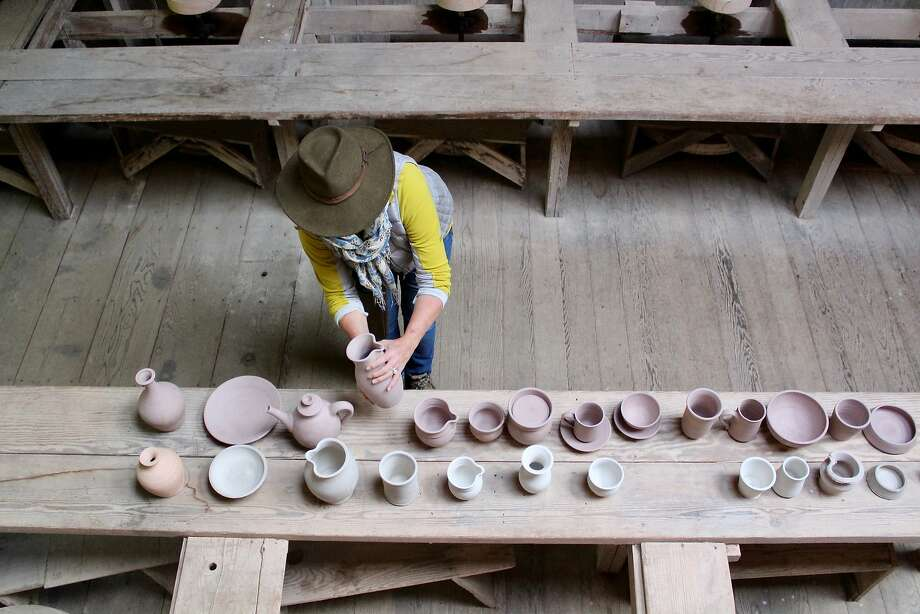 Laura Tyler Neely of Fairfax studies a pitcher, part of a display showing the teaching process used by master potter Marguerite Wildenhain at Austin Creek State Recreation Area near Guerneville. Photo: Harriot Manley / Special To The Chronicle