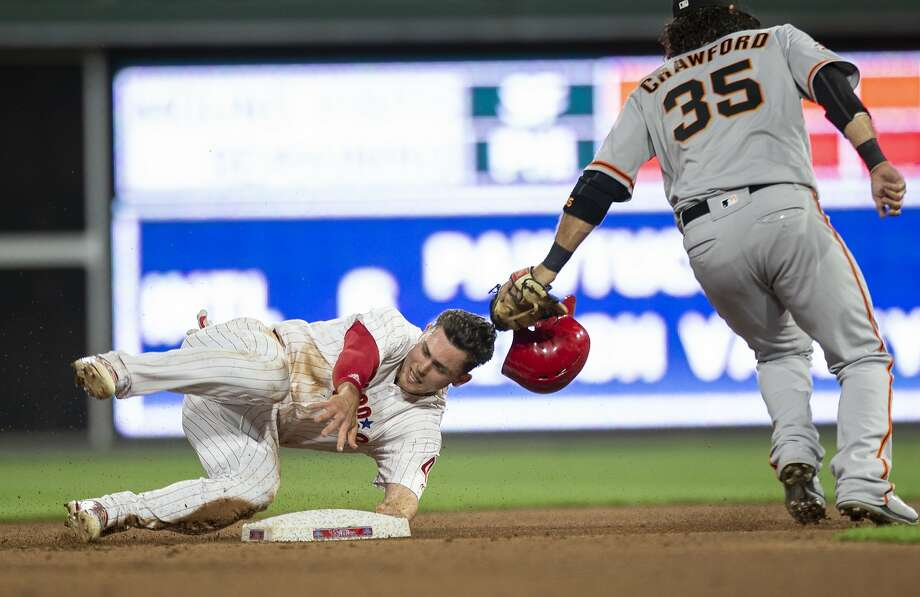 Philadelphia Phillies' Scott Kingery (4) is safe after stealing second base before San Francisco Giants shortstop Brandon Crawford (35) can make the tag in the fourth inning of a baseball game, Monday, May 7, 2018, in Philadelphia. (AP Photo/Laurence Kesterson) Photo: Laurence Kesterson / Associated Press