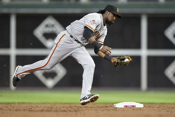 San Francisco Giants second baseman Alen Hanson (19) fields a grounder by Philadelphia Phillies' Maikel Franco during the third inning of a baseball game, Monday, May 7, 2018, in Philadelphia. (AP Photo/Laurence Kesterson)