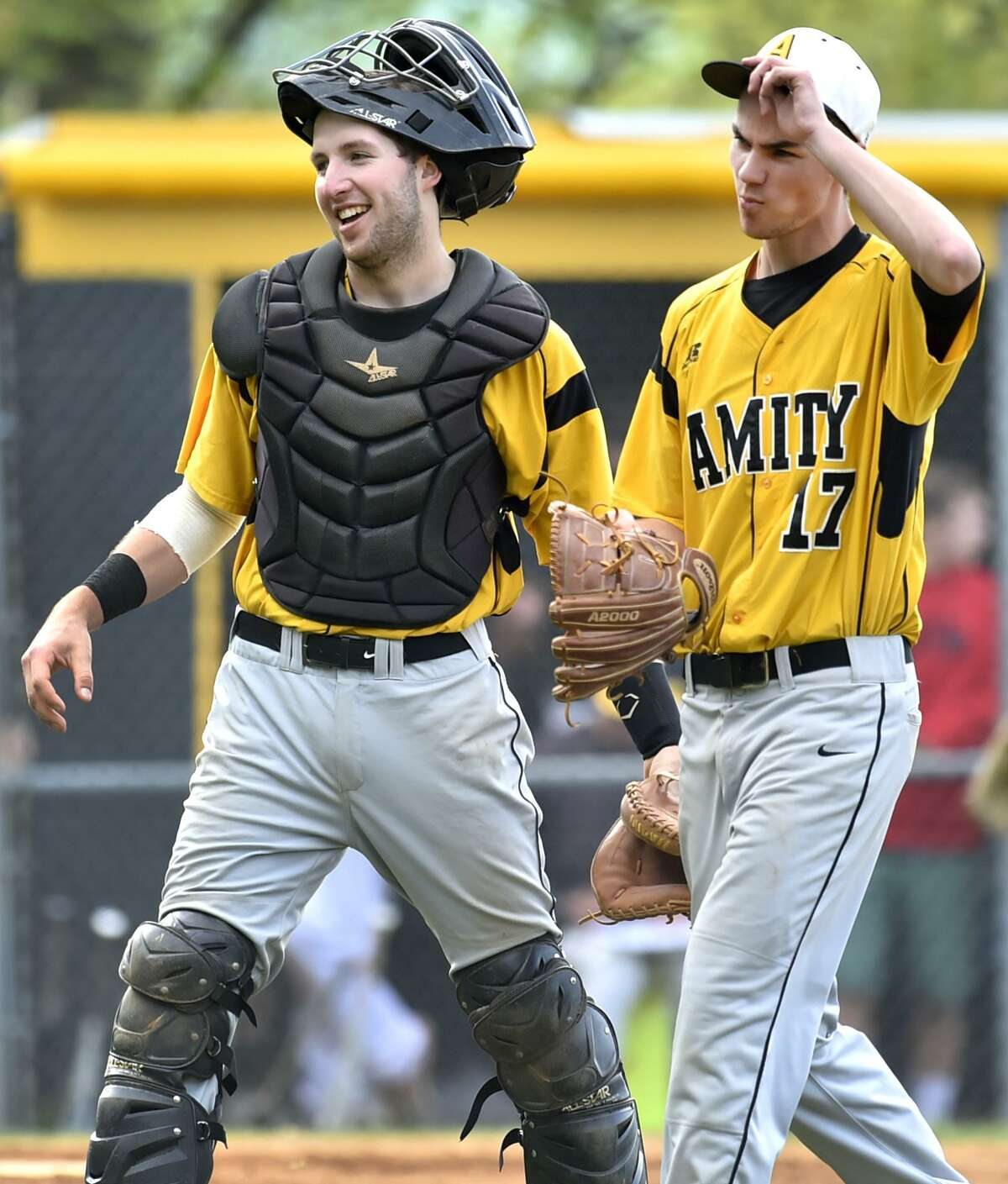 Amity's Pat Winkel, left, and pitcher Benjamin Lodewick head back to the dugout after retiring Hand at the end of fifth inning on Monday.