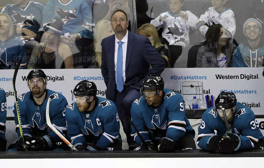 San Jose Sharks head coach Peter DeBoer, top, watches the scoreboard in the closing seconds of a 3-0 loss to the Vegas Golden Knights during the third period of Game 6 of an NHL hockey second-round playoff series, Sunday, May 6, 2018, in San Jose, Calif. (AP Photo/Marcio Jose Sanchez) Photo: Marcio Jose Sanchez / Associated Press