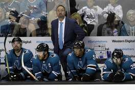 San Jose Sharks head coach Peter DeBoer, top, watches the scoreboard in the closing seconds of a 3-0 loss to the Vegas Golden Knights during the third period of Game 6 of an NHL hockey second-round playoff series, Sunday, May 6, 2018, in San Jose, Calif. (AP Photo/Marcio Jose Sanchez)