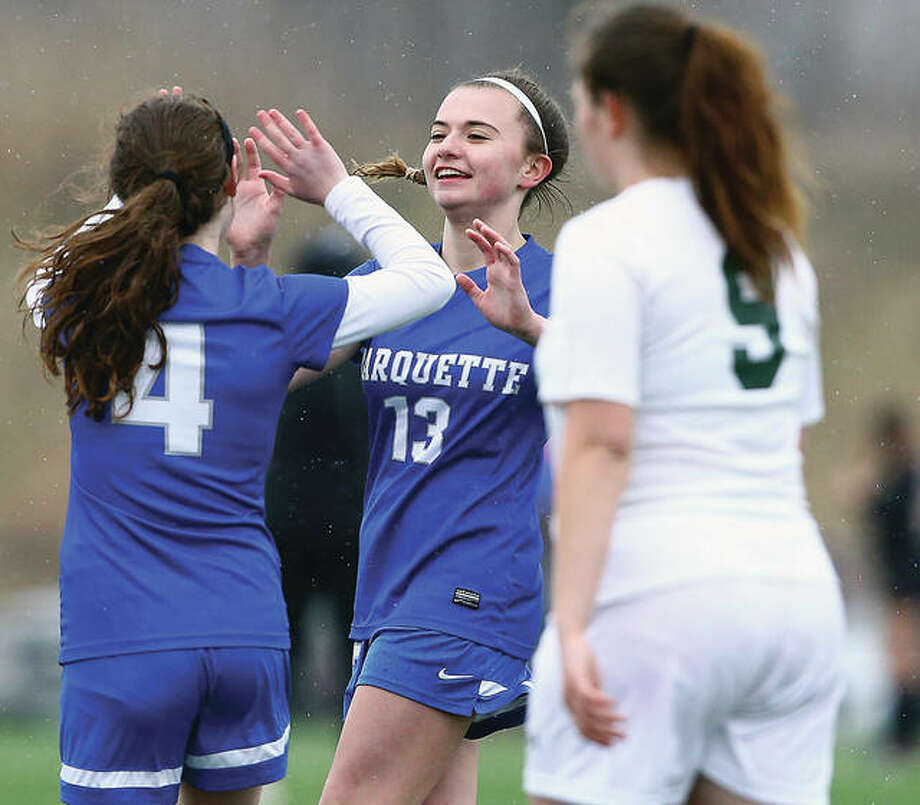 Marquette's Ellie Jacobs (13) celebrates with Madelyn Smith (4) during a victory earlier this season over DeSoto, Mo. Marquette will open the postseason Tuesday at 4 p.m. against EA-WR at Gordon Moore Park. Photo:       Billy Hurst | For The Telegraph