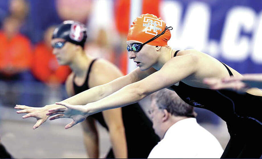 Tennessee's Bailey Grinter, a freshman from Edwardsville, gets set to swim her leg in the 400-yard relay at the NCAA Women's Championships earlier this year at Ohio State. Photo:     UT Vols Athletics