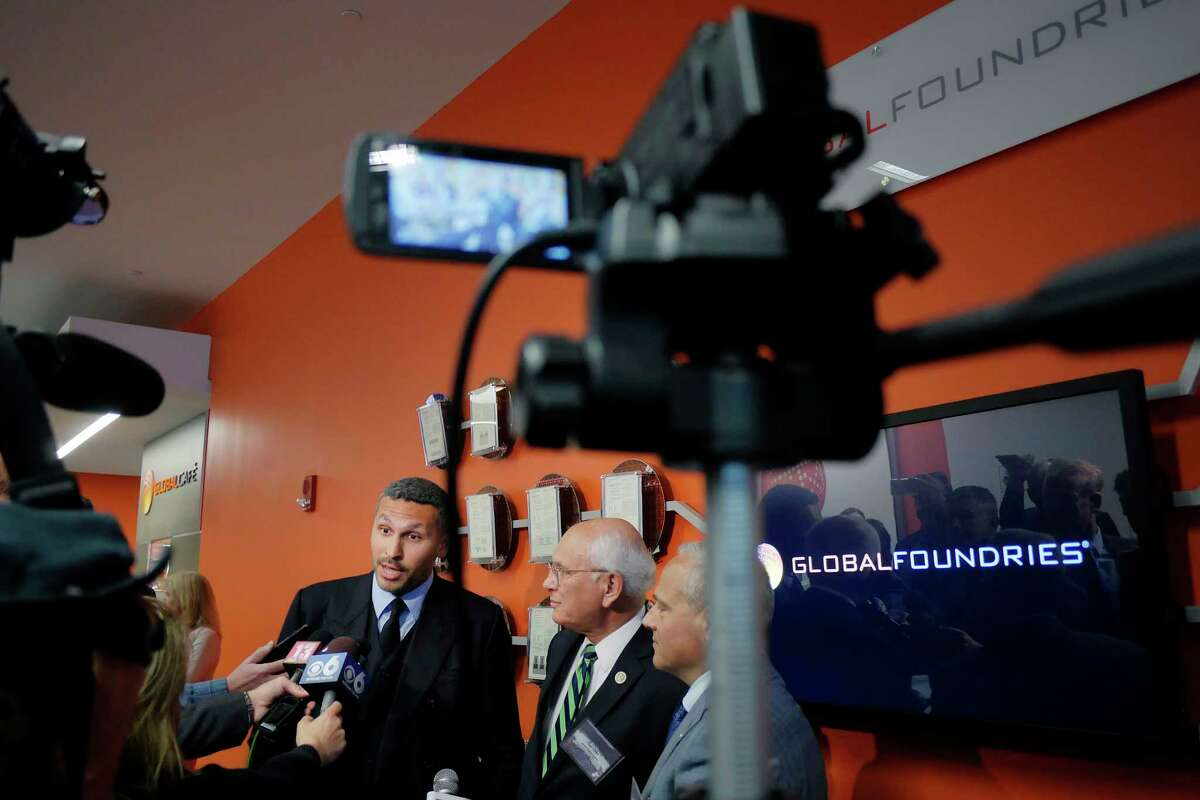 Khaldoon Khalifa Al Mubarak, left, CEO, Mubadala Investment Company, Congressman Paul Tonko, second from left, and Tom Caulfield, CEO, Globalfoundries, talk to members of the media following an event at GlobalFoundries on Monday, May 7, 2018, in Malta, N.Y. (Paul Buckowski/Times Union)
